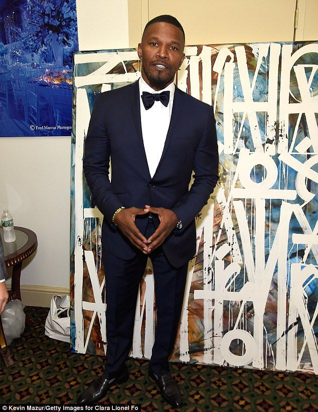 Sharp-dressed man: Jamie Foxx suited up in a stylish navy tuxedo for  Rihanna's third annual Diamond Ball at Cipriani Wall Street in Manhattan on  Thursday ...
