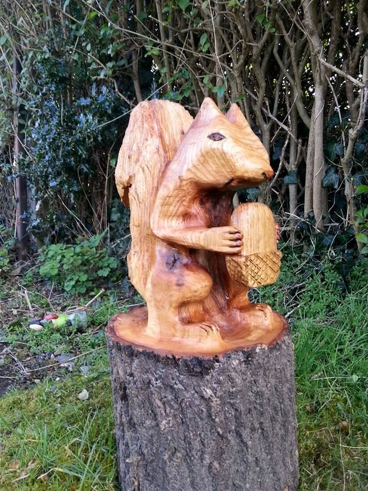 A chainsaw carved squirrel and acorn chainsaw carving chainsaw