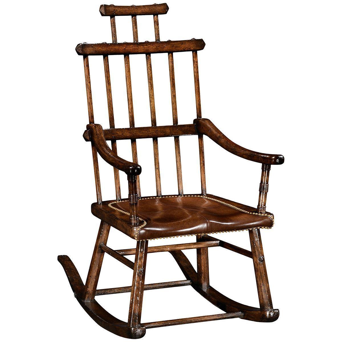 Heavily distressed oak windsor rocking armchair of unusual