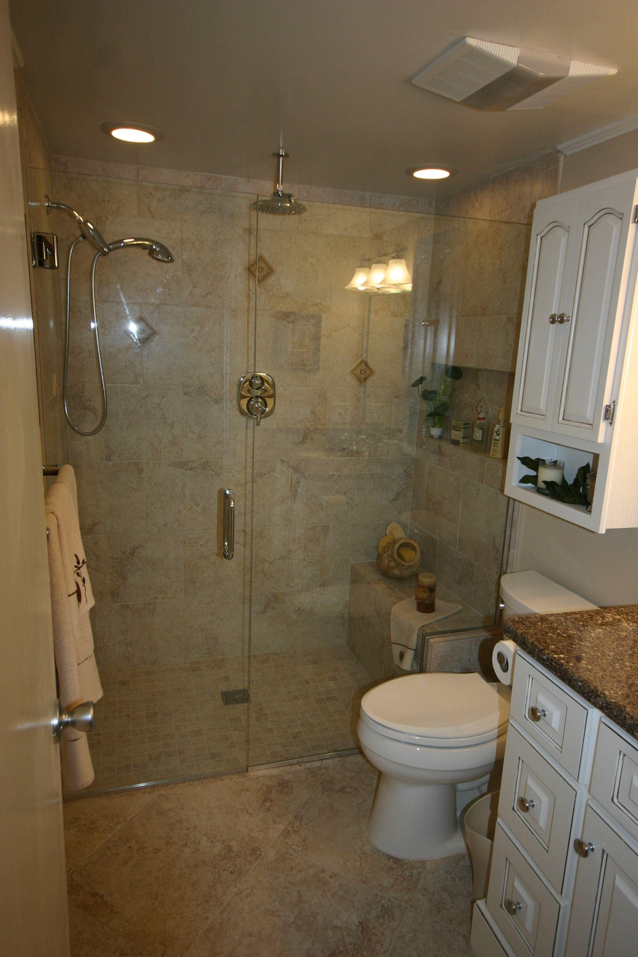 Custom curbless shower with multiple shower heads and built-in seat ...