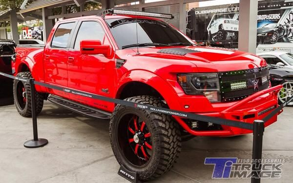 Glossy Red Lifted Ford F 150 Truck With Images Ford Raptor