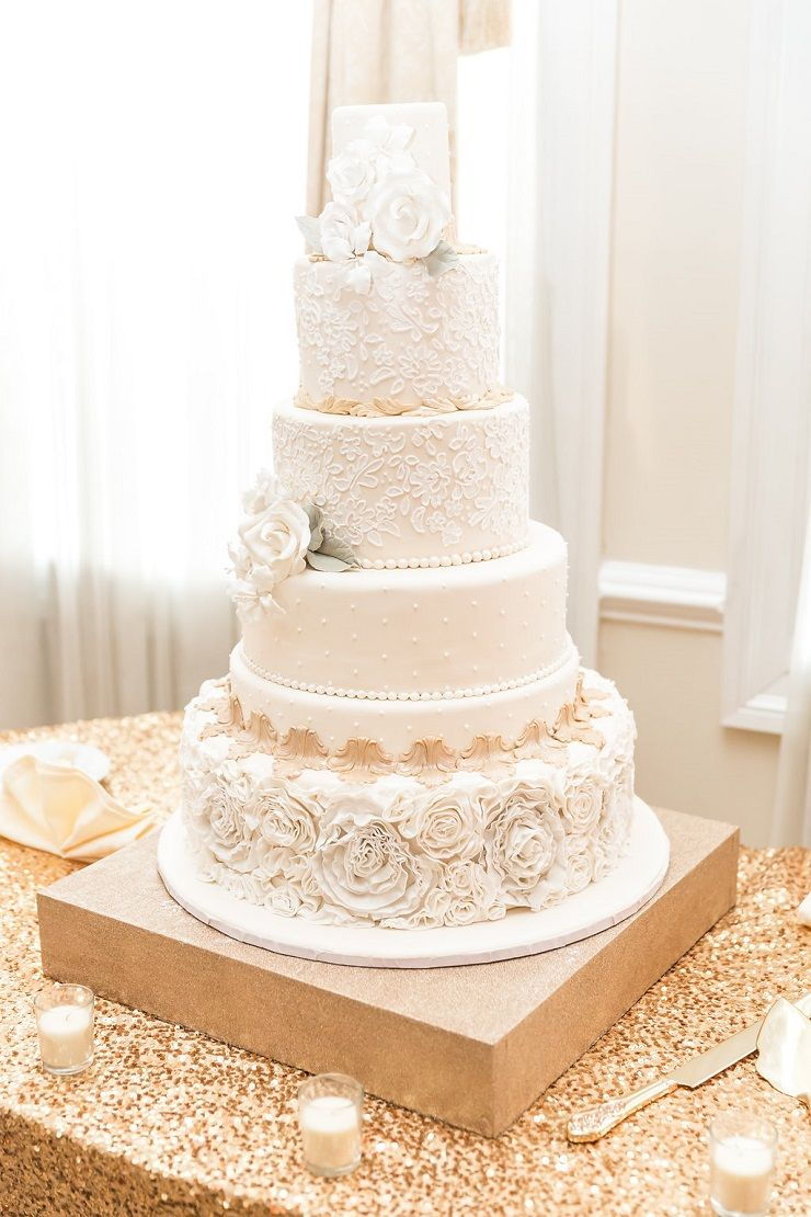 This Elegant Cream And Gold Lace Wedding Cake With Sugar Flowers Is
