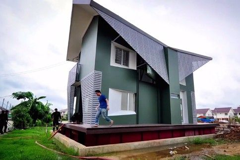"""Thai amphibious house - """"Hidden under the house and its wraparound porch are steel pontoons filled with Styrofoam. These can lift the structure three metres off the ground if this area, two hours north of Bangkok, floods as it did in 2011."""""""