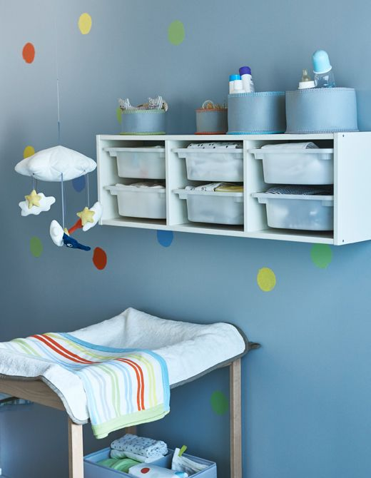Wall Storage Placed Above A Changing Table During Infant