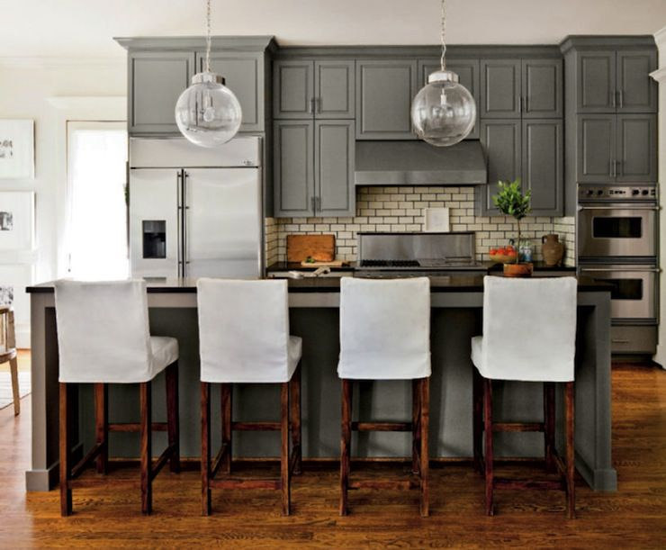 Gray cabinets black countertops creamy subway - Black granite countertops with cream cabinets ...