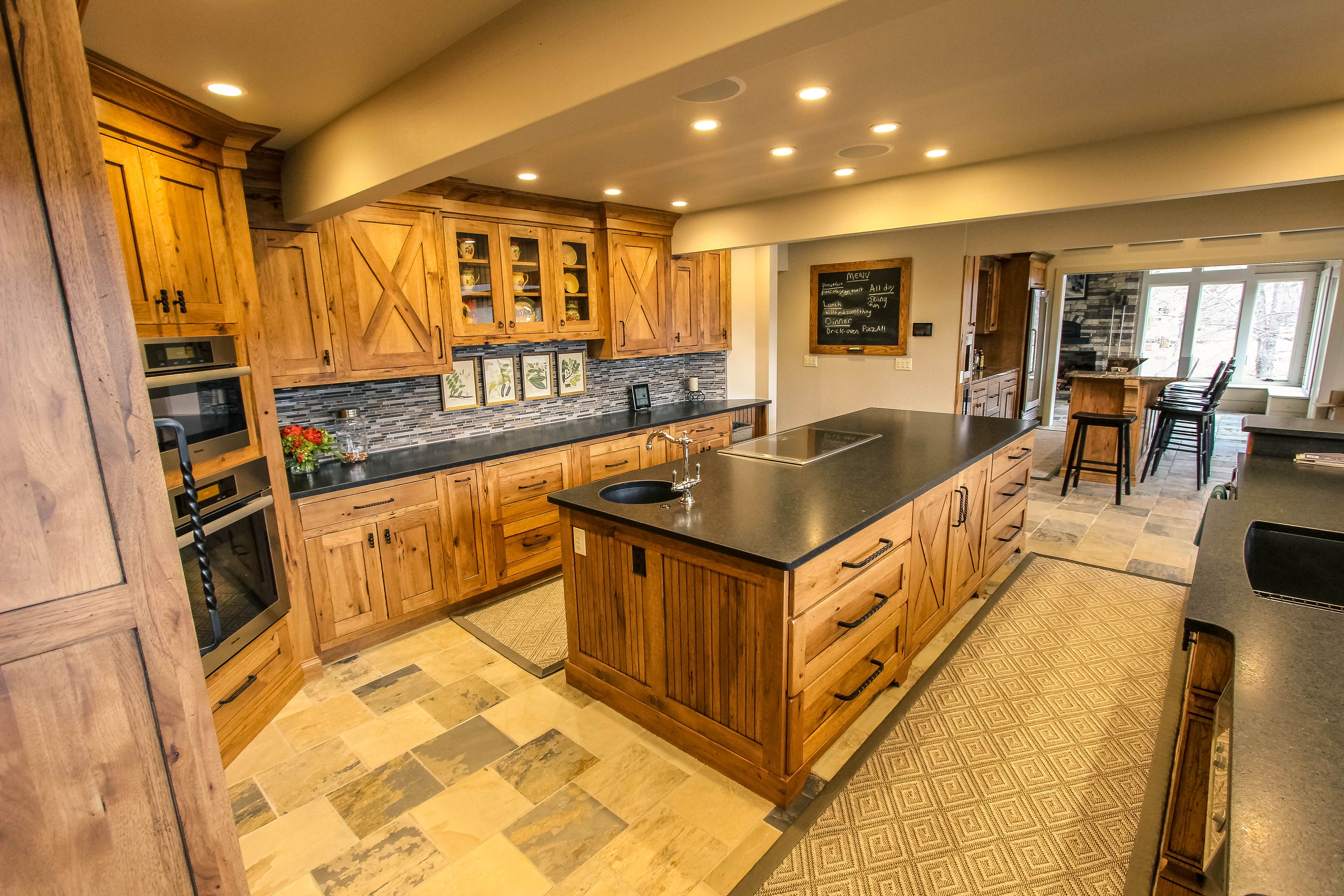 Black Granite Countertops Perfectly Compliment This Rustic Kitchen In D Granite Countertops Kitchen Black Granite Countertops Black Granite Countertops Kitchen