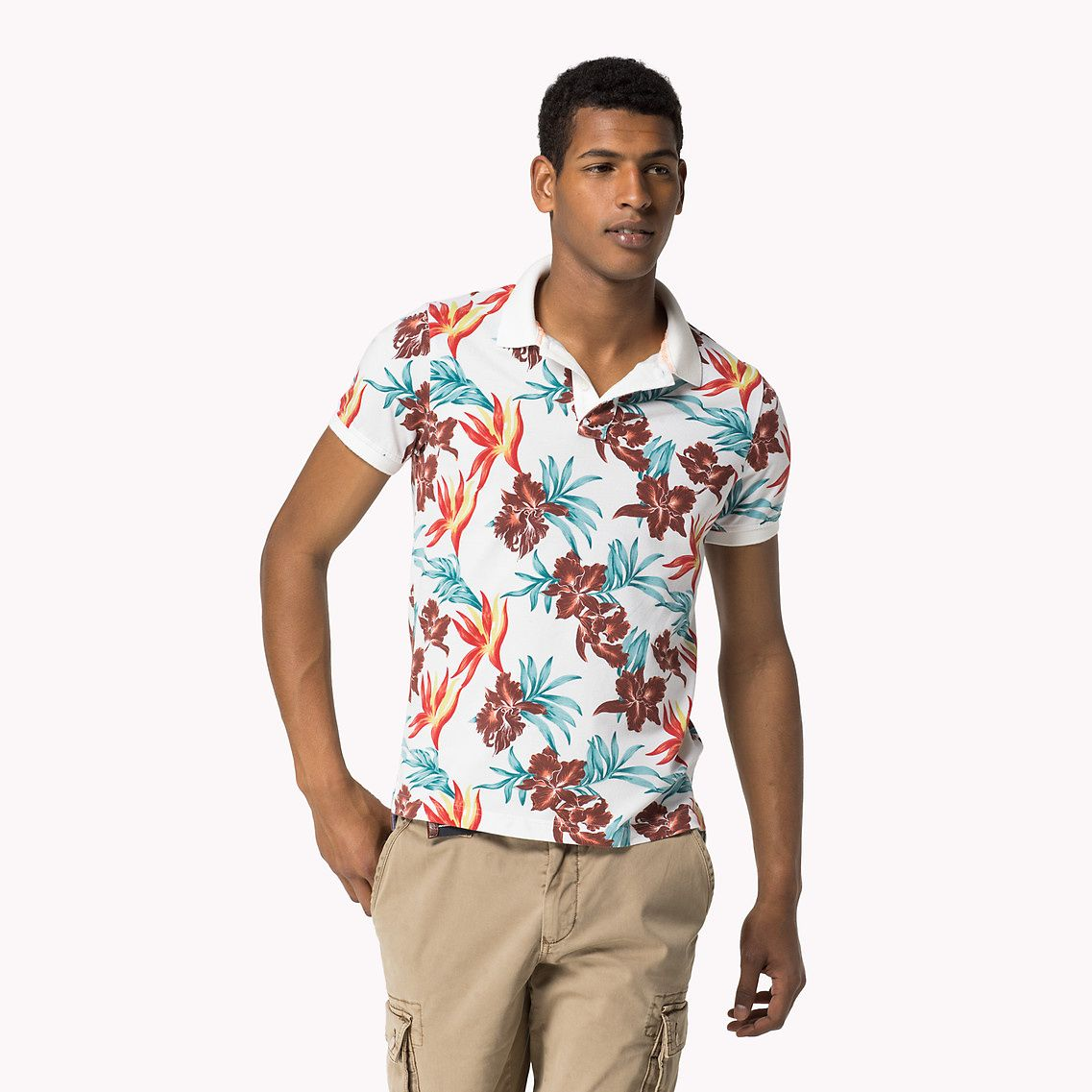 b659a7ad Stand out in this slim fit polo by Tommy Hilfiger with a tropical flower  print.