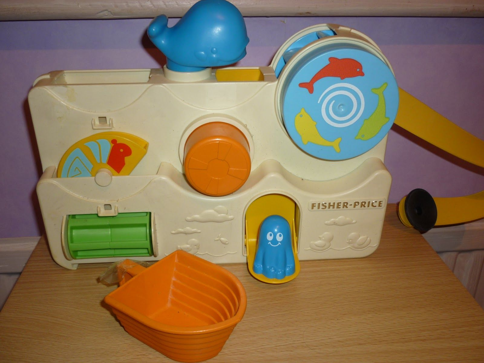 Fisher Price bath toy. It had suction cups to hang on the bathtub ...