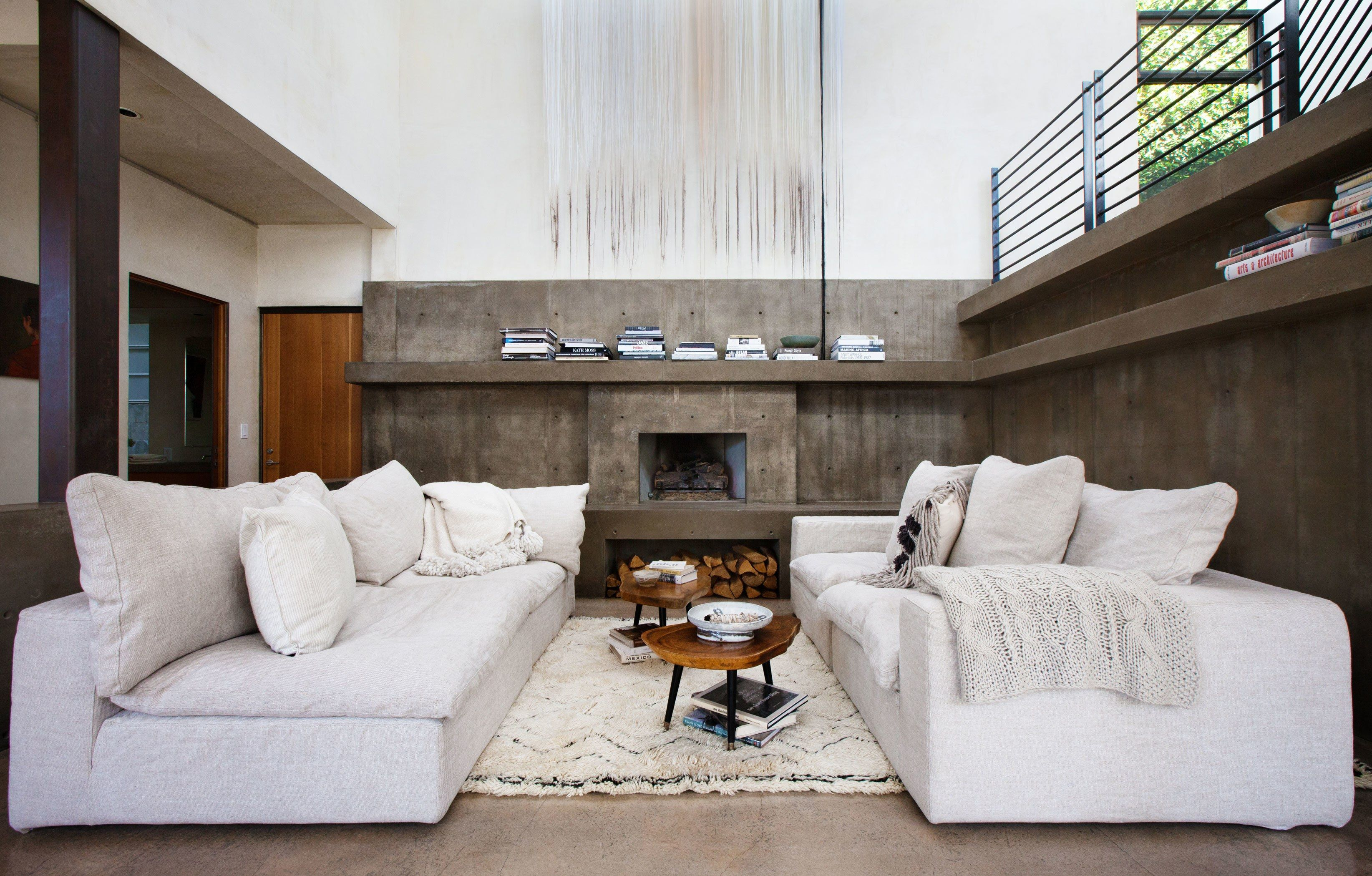 a modern glass and concrete home is warmed up with soft textures