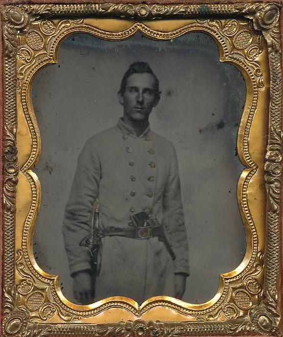 Double Armed Confederate  1/6 plate ambrotype of a Confederate officer in uniform.  Leather case with light purple plush.