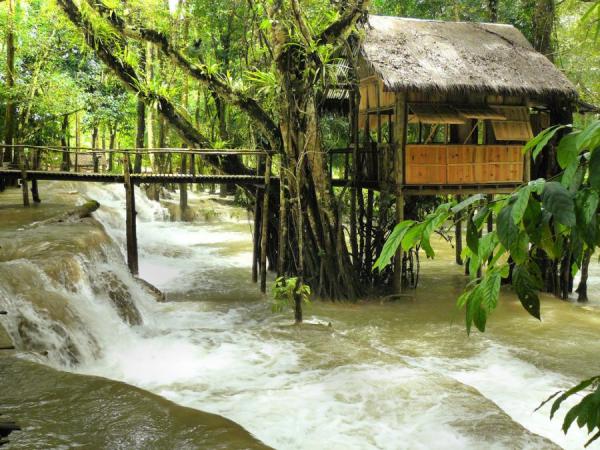A tiny house on the banks of the Nam Khan river. Luang Prabang, Laos.