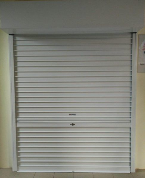 White Powder Coated Roller Shutters Installed At Sin Ming Road Activity Centre Roller Shutters Shutters Modern Shutters