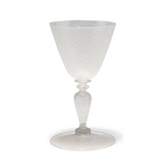 Murano. 'A reticello' tumbler, 16th century. H. 15 cm. Clear glass, glass rods, clear and opaque white, pricked air bubbles.
