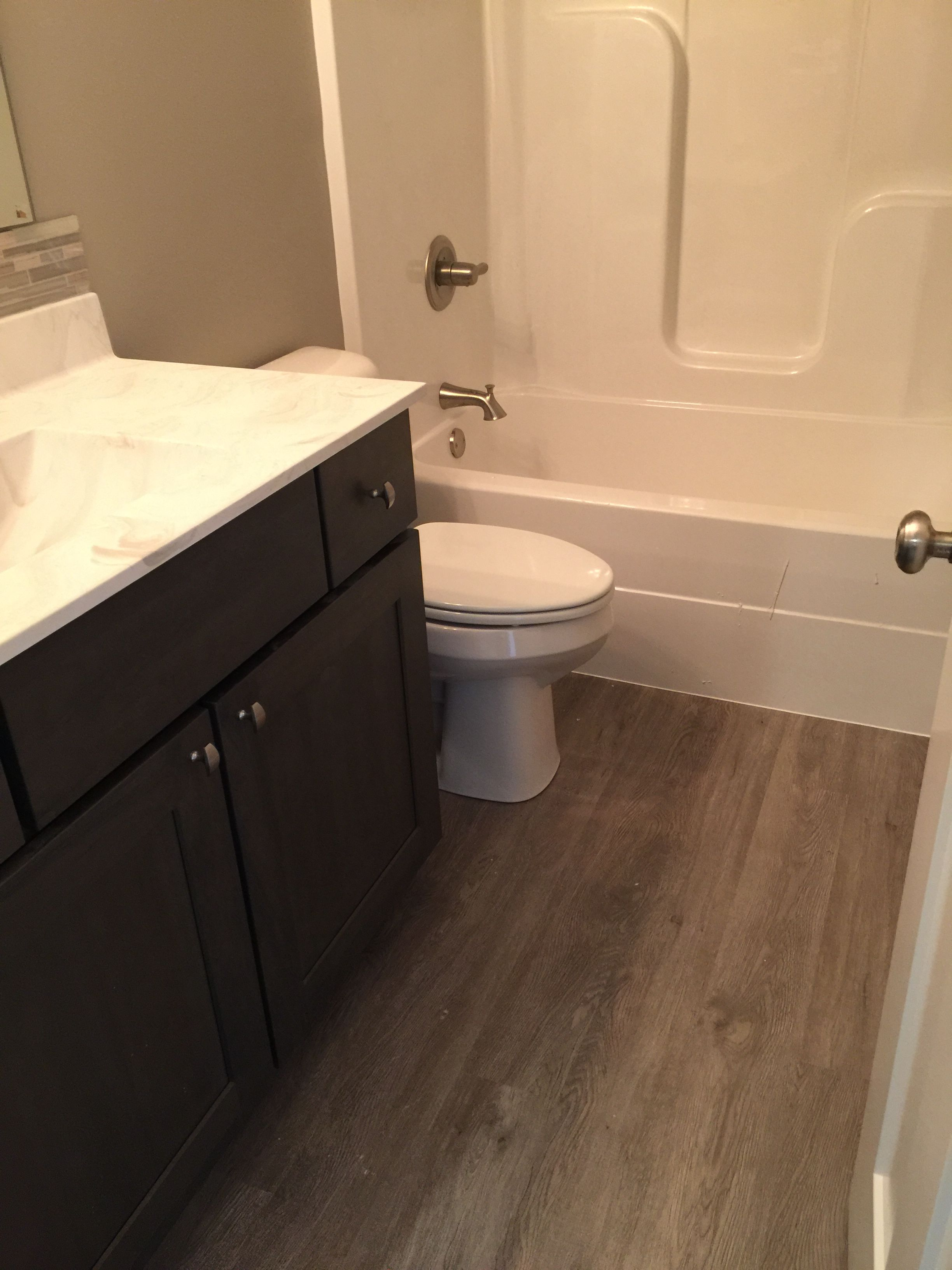 Bathroom With Coretec Flooring In Plymouth Oak Luxury Vinyl Plank Vinyl Plank Flooring Vinyl Plank Flooring Bathroom Luxury Vinyl Plank Flooring