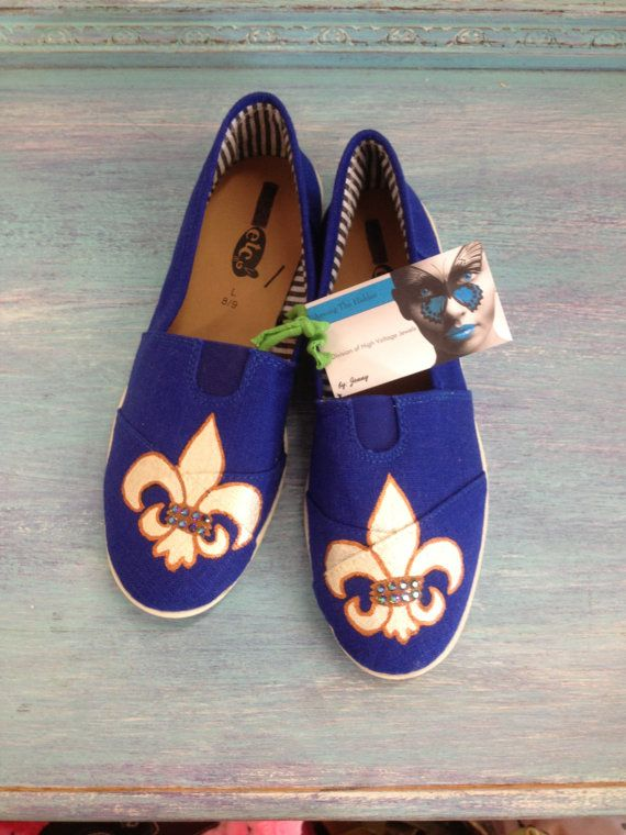 This pair is awfully close to navy blue. https://www.etsy.com/listing/115779629/vibrant-royal-blue-hand-painted-canvas
