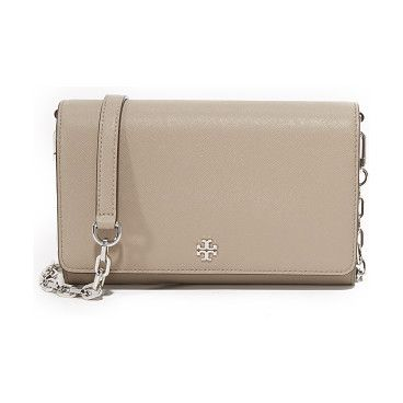 4925daced452 Robinson chain wallet by Tory Burch. A scaled down Tory Burch cross body bag  in sophisticated saffiano leather. Slim back pocket. Top flap and lined  inter.