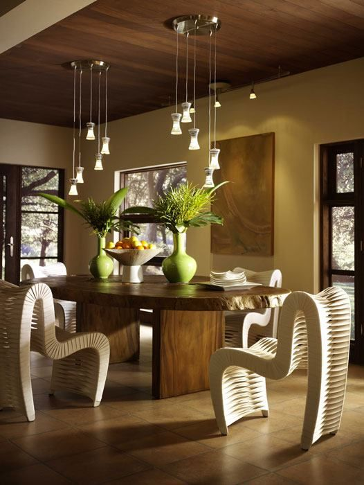 Eclectic Elements Feng Shui Tip:   Unique chairs like these and an all natural Wooden table can add creativity, balance and positive flowing energy into your space!