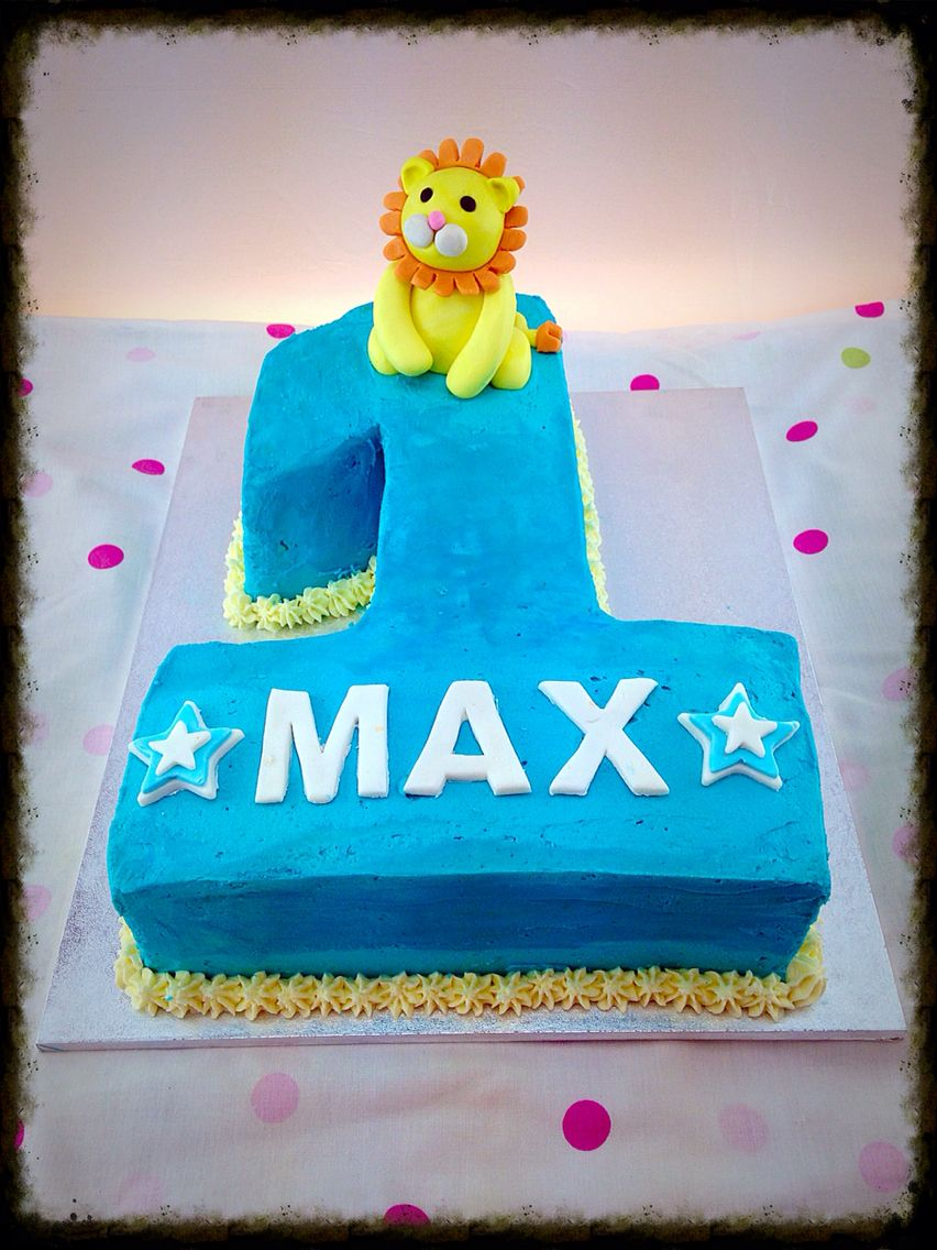 Number 1 birthday cake in blue with lion topper Lion