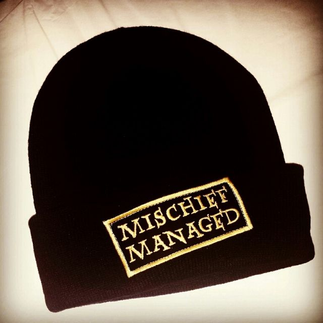Be just look Moony, Wormtail, Padfoot and Prongs, (or your favorite boy wizard) with this Mischief Managed cuffed beanie. Patch is set off center.   Adult one size fits most black cuffed beanie.