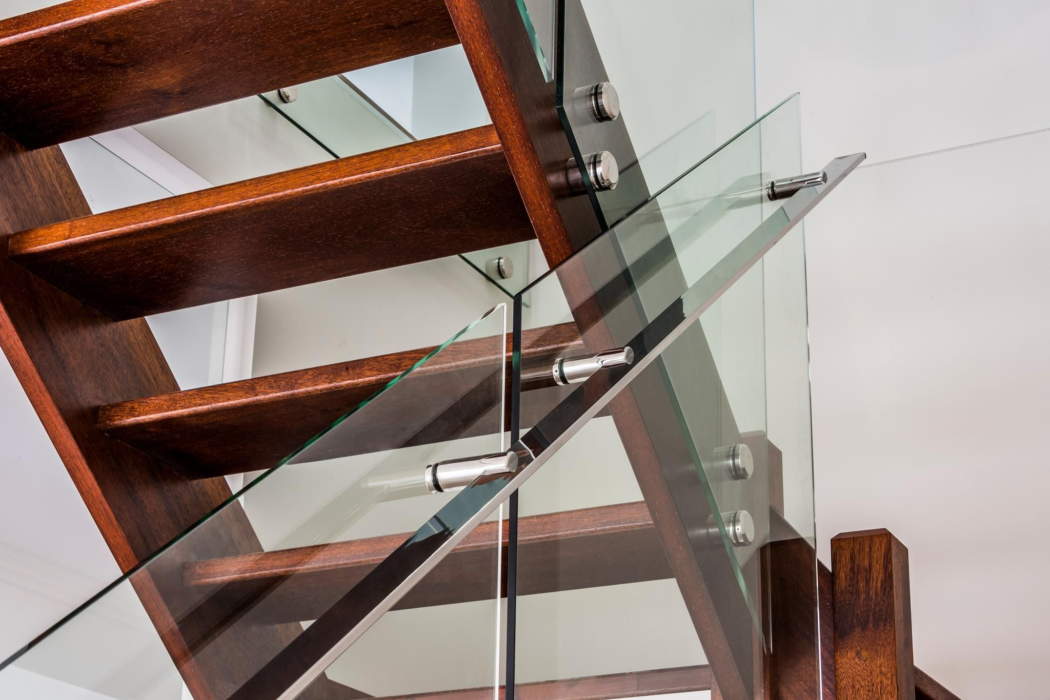 Glass balustrade on timber staircase Finished with custom made stainless steel handrails
