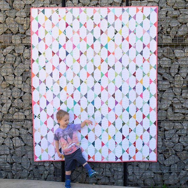 Finished! My Tula Pink #charmalong quilt made from over 100 different @tulapink prints (3-year-old for scale ). I used a design inspired by the Starpatch pattern by @shequiltsalot and free-motion quilted the background only to really make the prints pop. Thanks for organising the #aussiecharmswap @msmidge! I cant wait to see what everyone else has made with their Tula charms. #craft #quilt #quilting #patchwork #freemotionquilting #tulatroops #2016fal @finishalong.