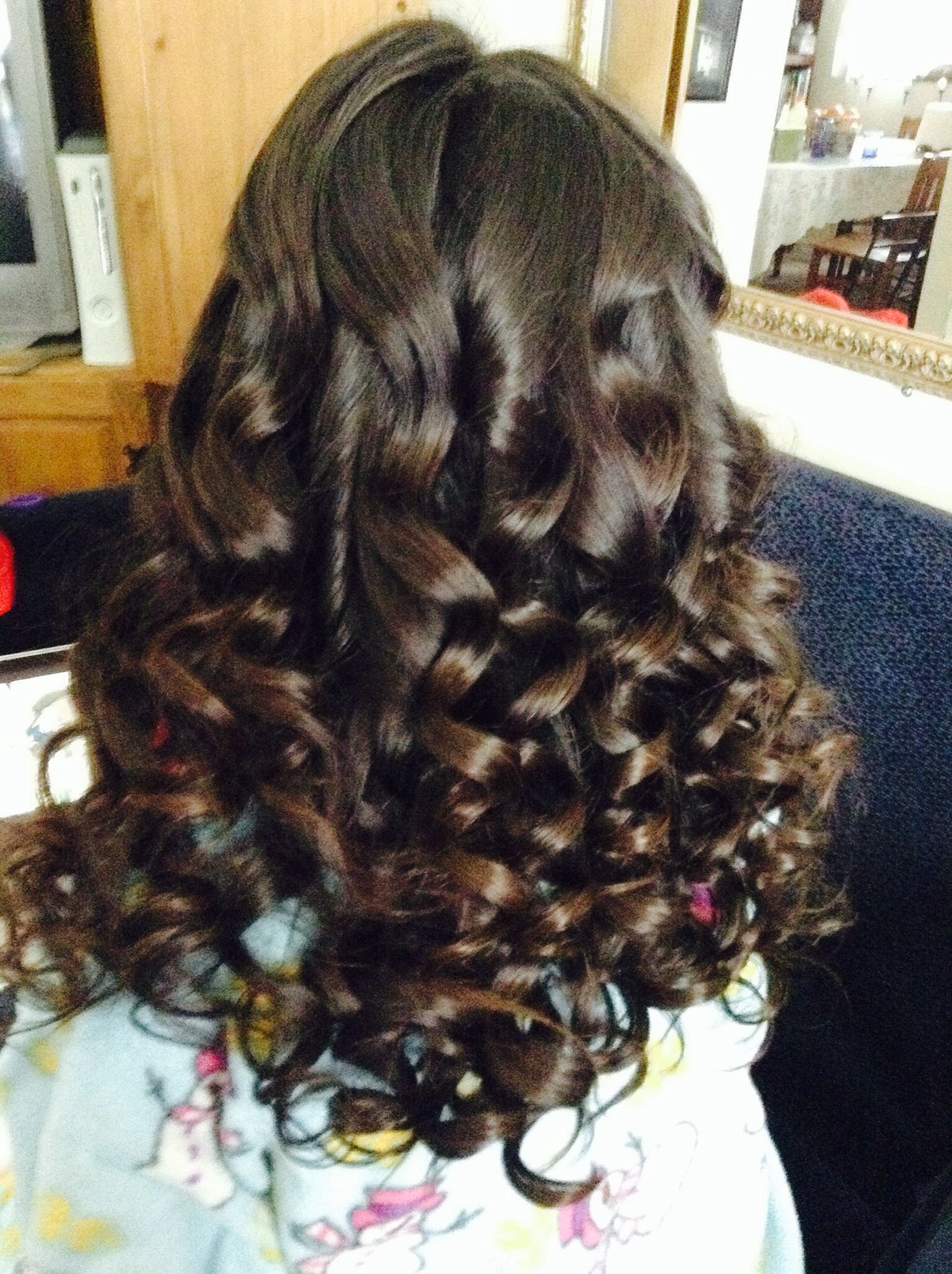 All over curls done with cone shaped curling iron