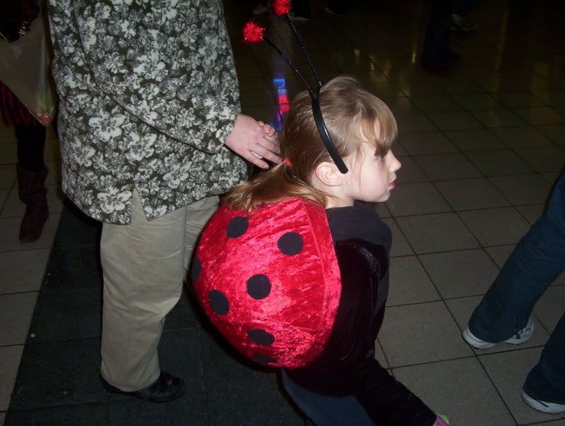 Ladybug costume- we used paper mache over a large rubber ball to make the shell, and then covered the inside and outside with fabric.