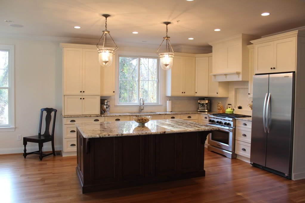 Brookhaven cabinets in antique white island in Matte Brown with