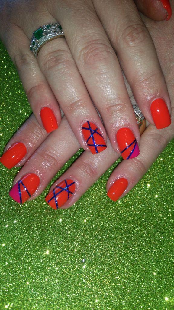 Orange nails with nail art stripes