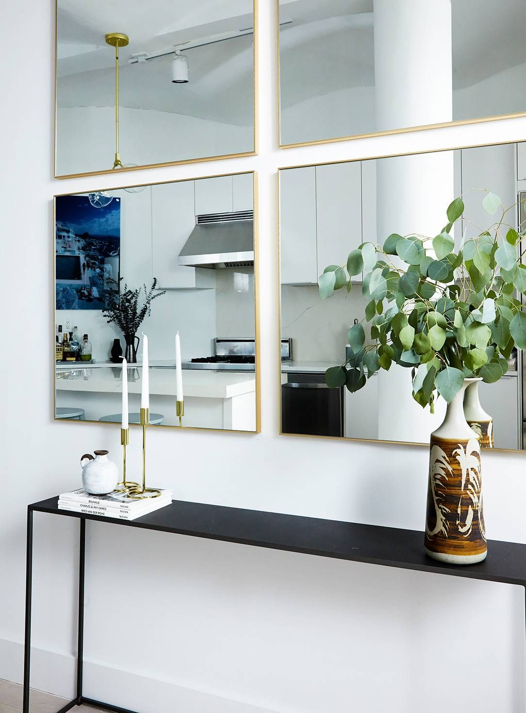tour an insanely stylish nyc loft with major scandinavian on ideas for decorating entryway contemporary wall mirrors id=35513