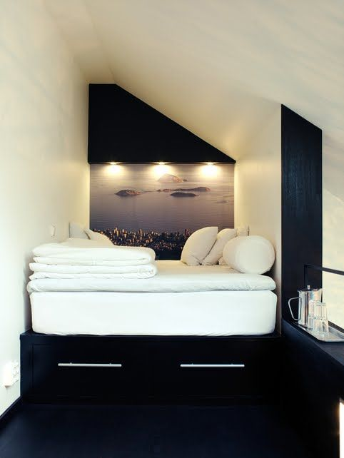 Chic black and white bedroom with an intimate bed alcove.  The high bed is extra cozy with a down featherbed mattress topper.