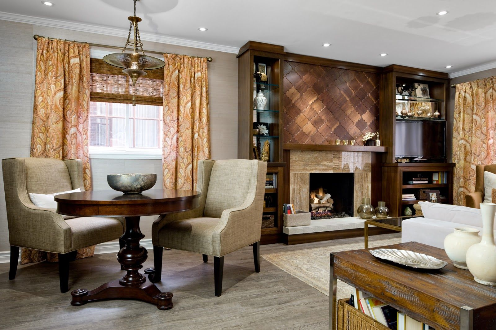 Candice Olson Design Genius Look At The Wood Floor Tiles Above Fireplace Living Room