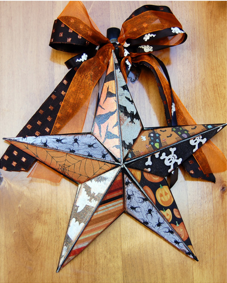 You could use an kind of scrapbook paper on a metal star like this!