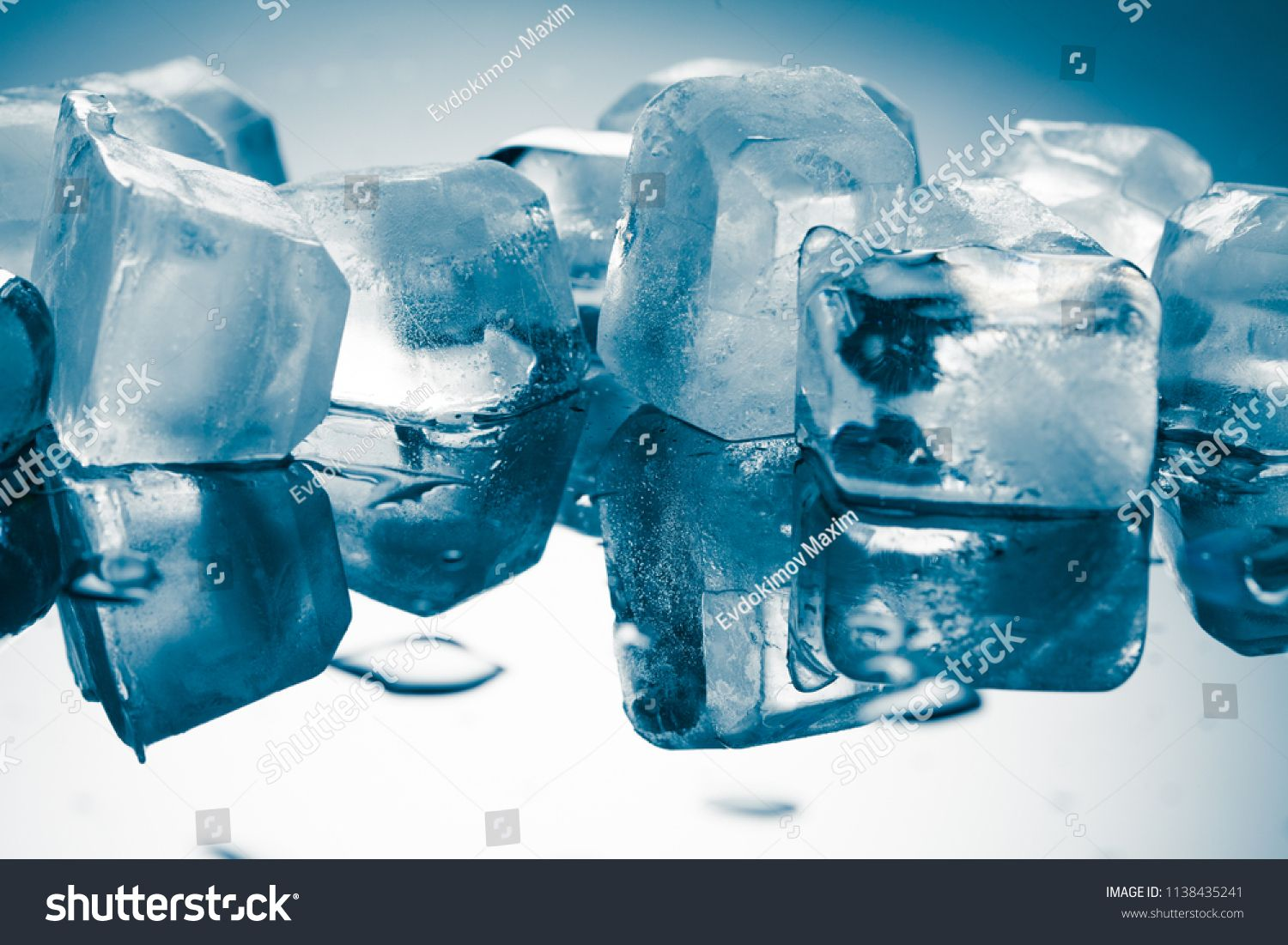 Melting Ice Cubes On A Glossy Table Sponsored
