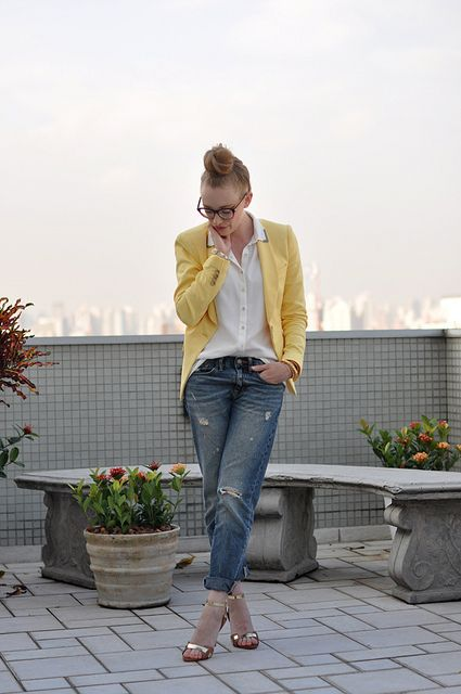 A yellow blazer brightens up a simple shirt and distressed denim