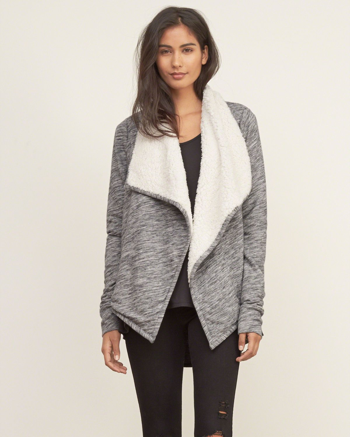 Make a statement effortlessly with this cardigan, featuring faux ...