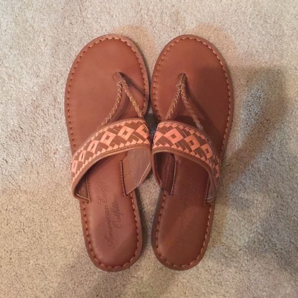 American Eagle Outfitters Sandals 8 These sandals are in great condition and are tan with a peach color woven in. Very cute and comfortable! Soles are in great condition. Listed for less with cheaper shipping on Merc. American Eagle Outfitters Shoes