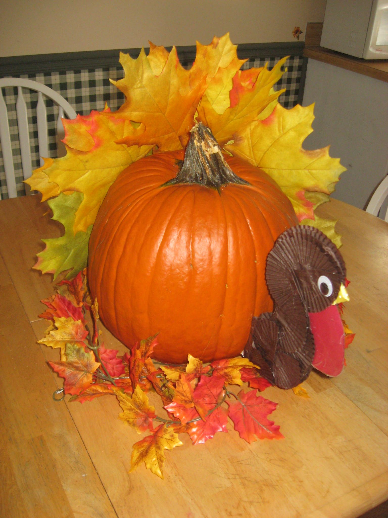 turkey i made from recycled halloween pumpkin.. Fall