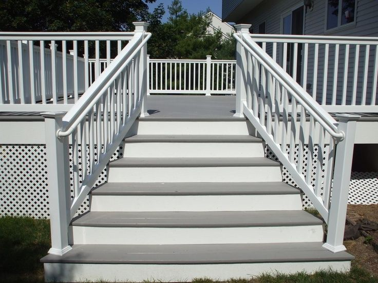 Grey And White Decking With White Vinyl Railing Looks