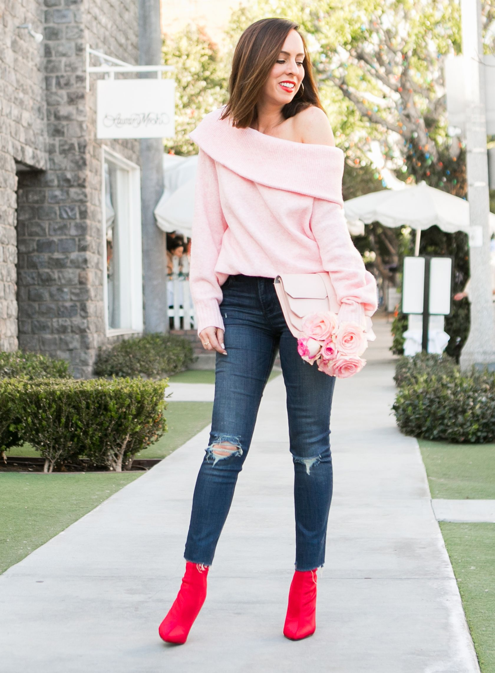 b571e7ac545202 Sydne Style gives valentines day outfit ideas wearing pink and red in sock  booties. Shop the look on the blog!  pink  red  jeans  booties  outfits