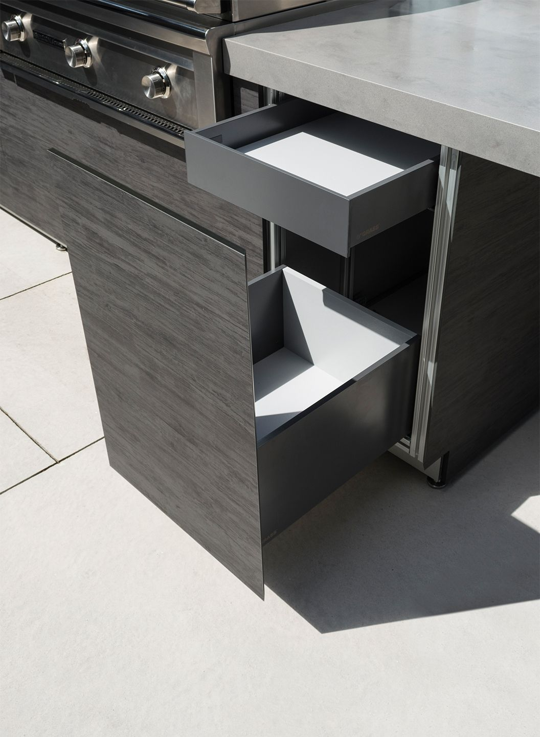 Built In Storage Bin Drawer With Inset For Grilling Equipment Outdoor Kitchen Cabinetry Canada Outdoor Kitchen Contemporary Kitchen Contemporary Outdoor