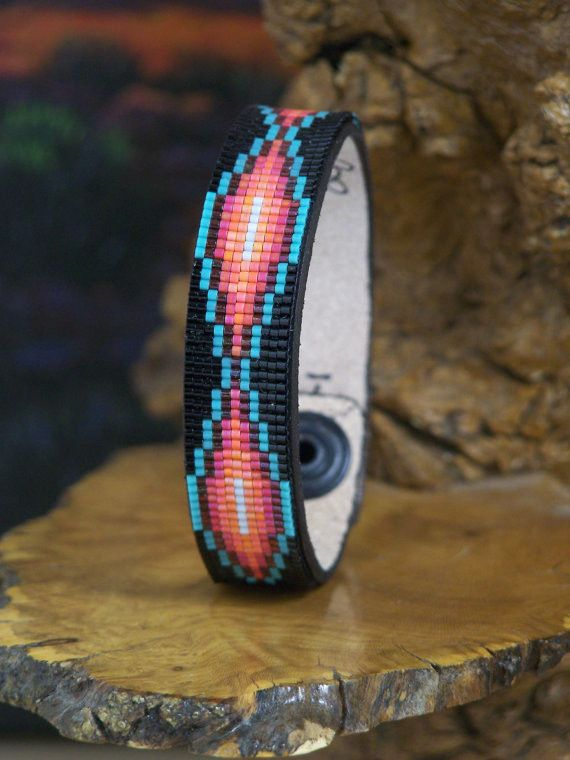 This American Indian beaded bracelet is made in a pattern I found on a Navajo Rug. I beaded this bracelet with the blends of soft fire colors of the Southwest along with a shimmering black background