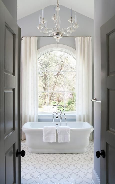 Elegant Traditional Bathroom Features A Calacatta Tia And Honed - Elegant-traditional-bathrooms