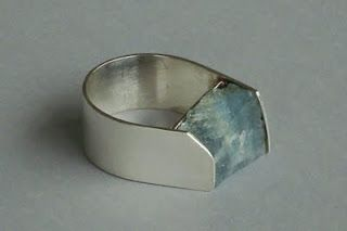 This would be gorgeous with any stone or gem.......maybe a chocolate diamond. :)