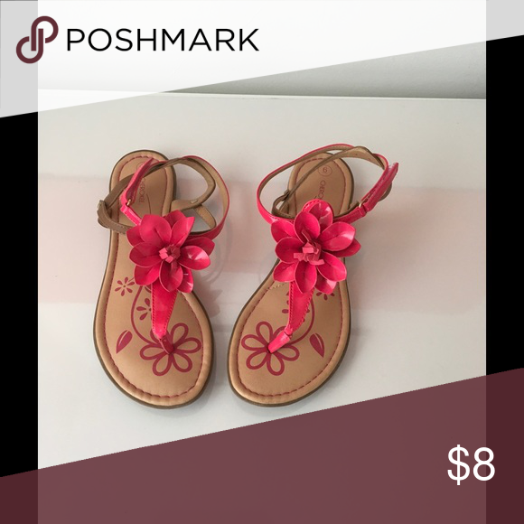 Pink sandals Beautiful pink flower 🌺 in the front gives the sandals nice detail. Like new. Cherokee Shoes Flats & Loafers