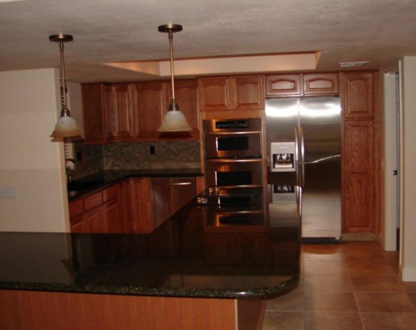 KraftMaid Fawn Oak Cabinets With Granite Countertop.