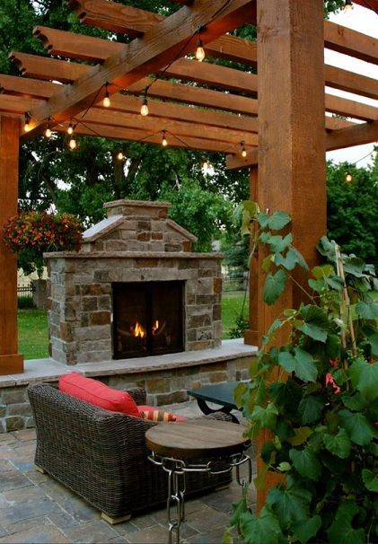 Outdoor fireplace Thinking a pizza oven instead of the bbq OR a