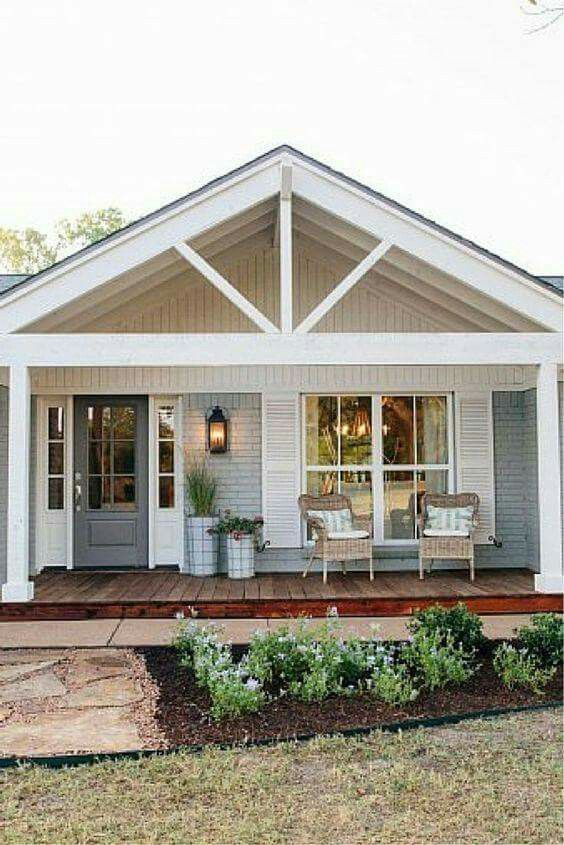 Cottage layout front porch with door to left and gabled covered porch