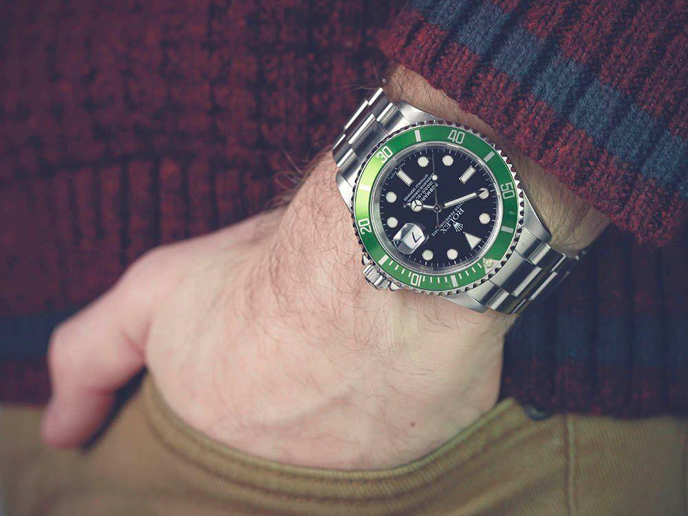rolex submariner mens watch on hand
