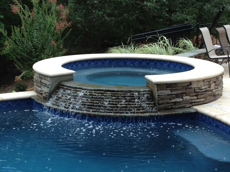 Raised stone spa with spillover pools spas pinterest for Raised pool designs